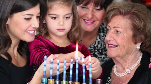 MS Four Generations of Jewish Women Lighting Hannukah Candles / Richmond, Virginia, USA