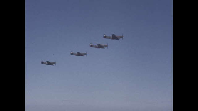 Four German WWII Fighter Planes Fly in Formation