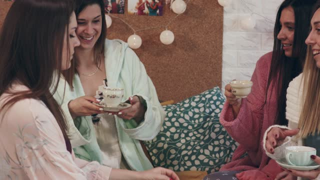four girlfriends sitting in bed, enjoying tea and relaxing together - nightwear stock videos & royalty-free footage