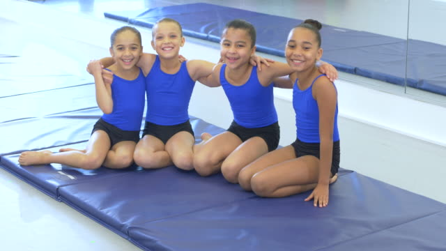four girls in gymnastics class - 10 11 years stock videos & royalty-free footage