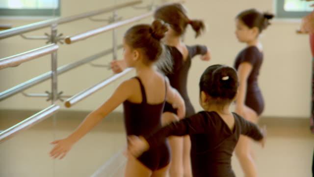 cu, tu, four girls (6-7, 8-9) practicing ballet in ballet class, richmond, virginia, usa - pirouette stock videos and b-roll footage