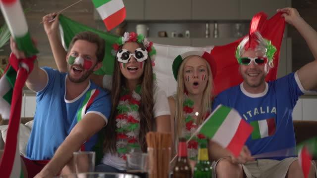 stockvideo's en b-roll-footage met four happy italian soccer fans - italian culture