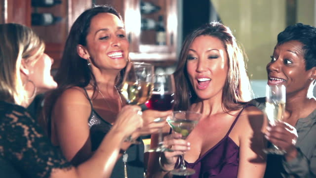 four happy multi-ethnic women drinking at a party - fidanzata video stock e b–roll