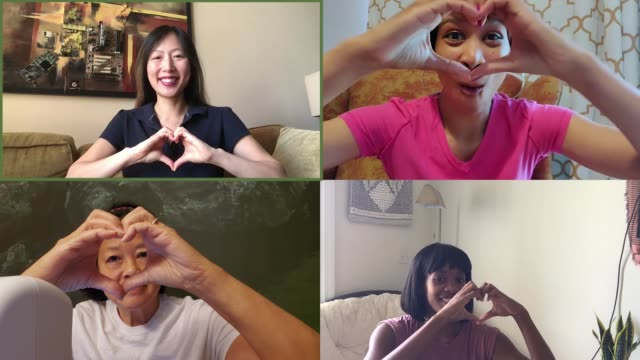 four happy women make hearts with their hands on a video call - heart shape stock videos & royalty-free footage