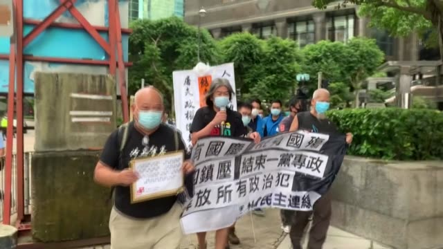 four hong kong pro-democracy activists march towards the venue of an official ceremony to celebrate china's national day, chanting slogans such as... - orthographic symbol stock videos & royalty-free footage