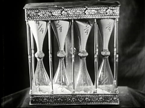 1943 cu four hourglasses side by side, each timer marked with different fraction of an hour/ audio - four objects stock videos & royalty-free footage