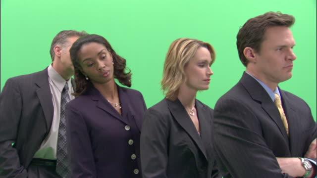 MS, Four impatient businesspeople standing in line in studio
