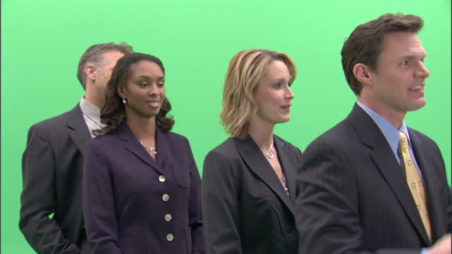 ms, four impatient businesspeople standing in line in studio - annoying colleague stock videos & royalty-free footage