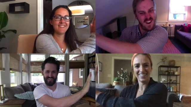 four joyful millennial friends high-five each other on conference call - video call stock videos & royalty-free footage