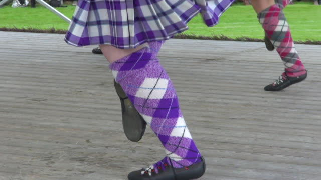 cu four lady highland dancing at braemar royal highland games / braemar, aberdeenshire, scotland - highland games stock videos & royalty-free footage