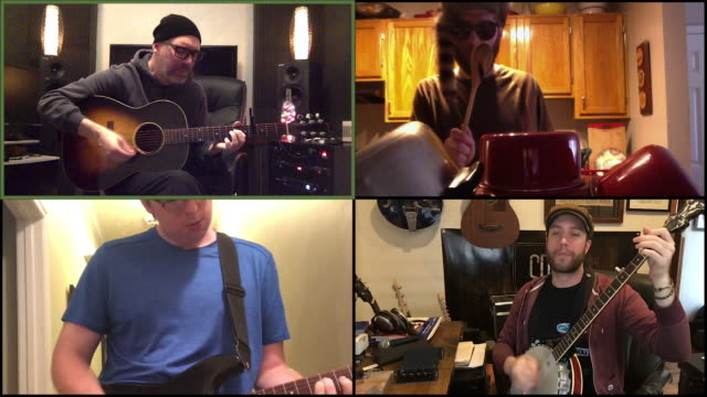 stockvideo's en b-roll-footage met four male musicans jam out together via video conference call. - muzikant