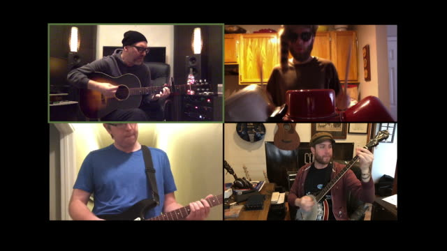 four male musicans play music together via video conference call. - エレキギター点の映像素材/bロール