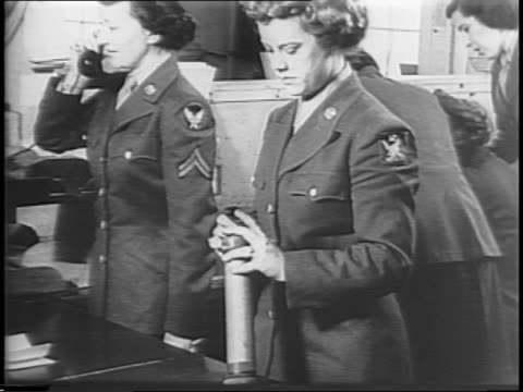 four members of women's army corp meet at table with general / women work in office and message center / women operate switchboard typewriters and... - us airforce stock videos & royalty-free footage