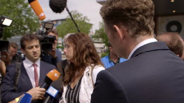 stockvideo's en b-roll-footage met four men charged with murder over shooting down of malaysian airlines flight mh17 netherlands utrecht ext silene fredriksz speaking to press - crime and murder