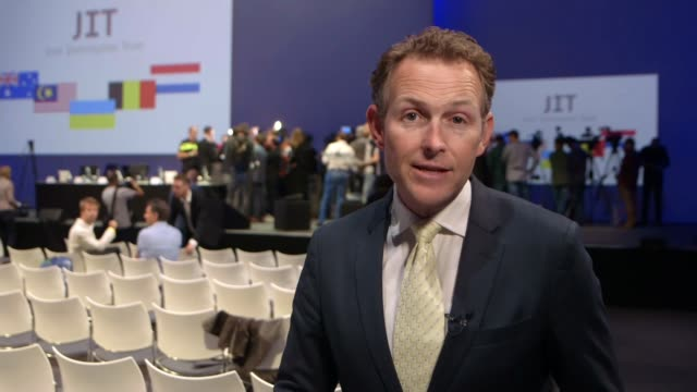 stockvideo's en b-roll-footage met four men charged with murder over shooting down of malaysian airlines flight mh17 netherlands utrecht int reporter to camera - crime and murder