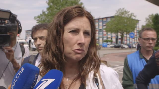 stockvideo's en b-roll-footage met four men charged with murder over shooting down of malaysian airlines flight mh17 netherlands utrecht ext silene fredriksz interview sot - crime and murder