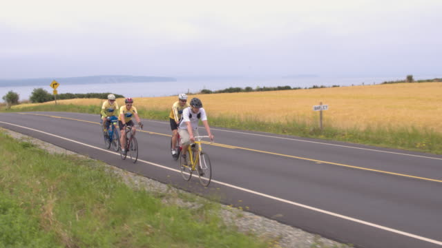 four men cycling on a rural road - pacific northwest usa stock videos & royalty-free footage