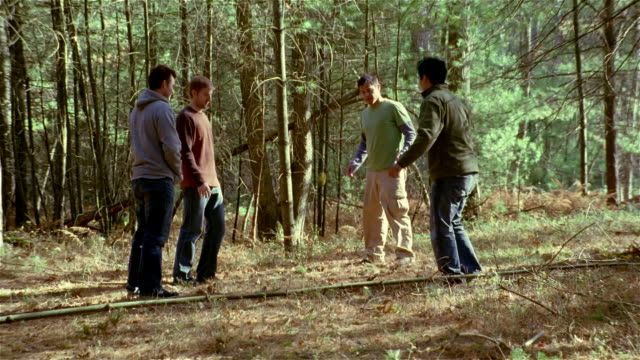 four men playing hacky sack in the woods - bean bag stock videos & royalty-free footage