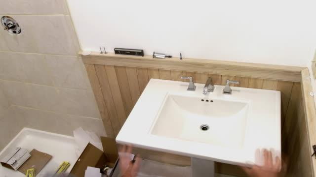 T/L, MS, HA, Four men renovating bathroom