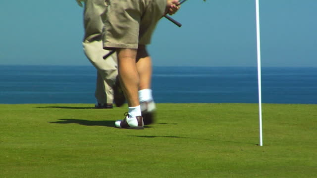 cu, pan, four men walking on golf course, low section, rear view, north truro, massachusetts, usa - golf shoe stock videos & royalty-free footage
