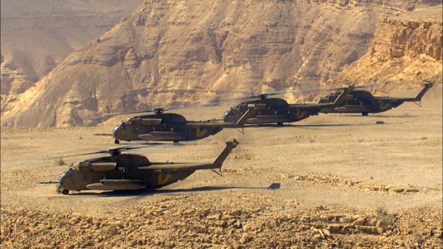 aerial four military helicopters in the negev desert, israel - israelisches militär stock-videos und b-roll-filmmaterial