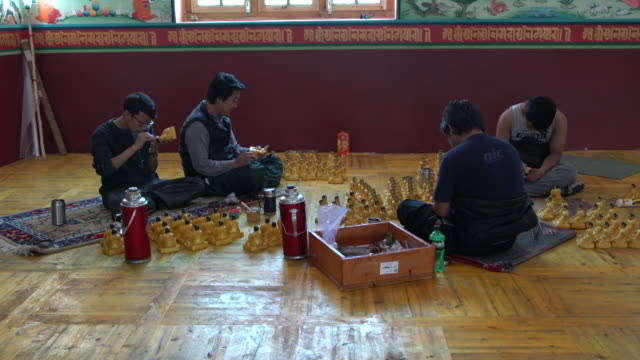 Four Monks Working On Small Buddha Statutes In Phyang Monastery, Ladakh