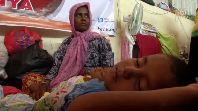 Four monthold Mohammed Yakup Ali who was born on a refugee boat is seen at a temporary shelter in Aceh in Indonesia on May 27 2015 A Rohingya refugee...