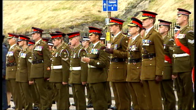 four more british soldiers killed including first female officer scotland edinburgh ext prince harry on parade with other servicemen and women along... - royal mile stock videos and b-roll footage