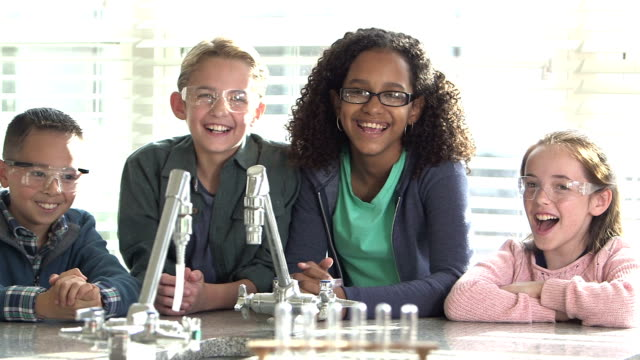four multi-ethnic children in science lab - 10 11 years stock videos & royalty-free footage