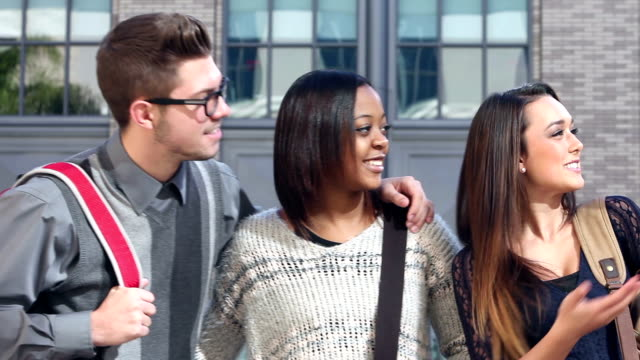 Four multi-ethnic high school students talking