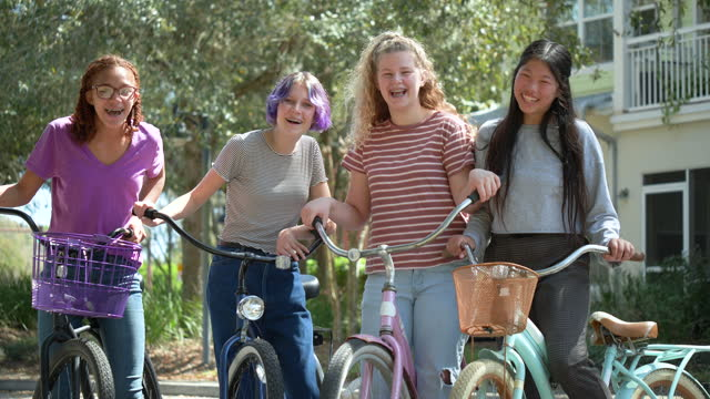four multi-ethnic tween girls with bicycles, laughing - 12 13 years stock videos & royalty-free footage