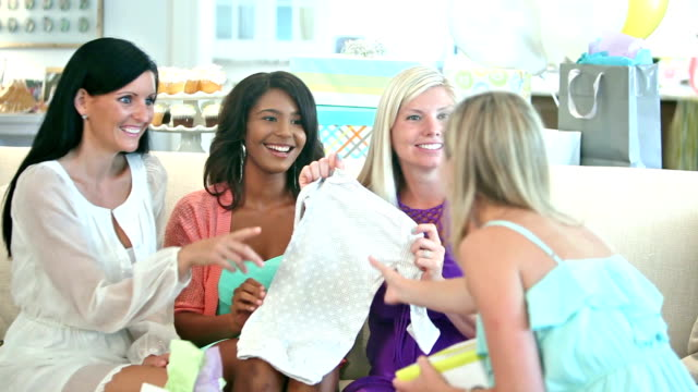 four multi-ethnic women at baby shower opening gifts - baby shower stock videos and b-roll footage