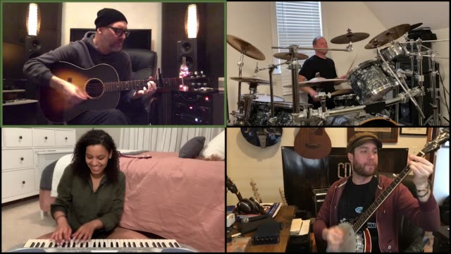four musicians remotely jam out together via video call. - guitar stock videos & royalty-free footage