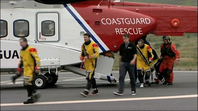 four offshore oil workers killed in helicopter crash location unknown day survivors from the helicopter crash wearing immersion suits from coastguard... - coast guard stock videos and b-roll footage