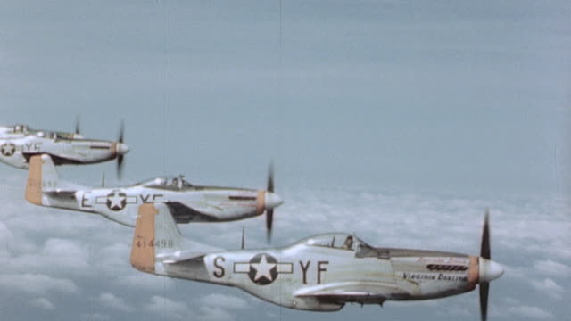 Four P51 Mustangs flying in formation and peeling off / Germany