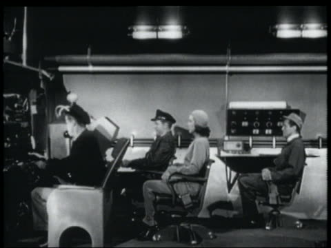 vidéos et rushes de b/w 1952 four passengers sitting in cockpit of spaceship - 1952