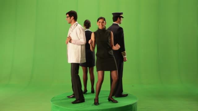 four people dancing  - air stewardess stock videos & royalty-free footage