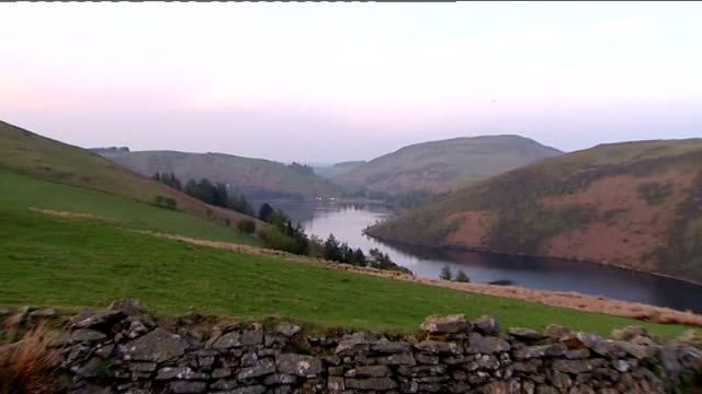 four people feared dead after car plunges into reservoir in wales wales powys near llanidloes ext general view of reservoir zoom in ambulances and... - powys stock videos & royalty-free footage