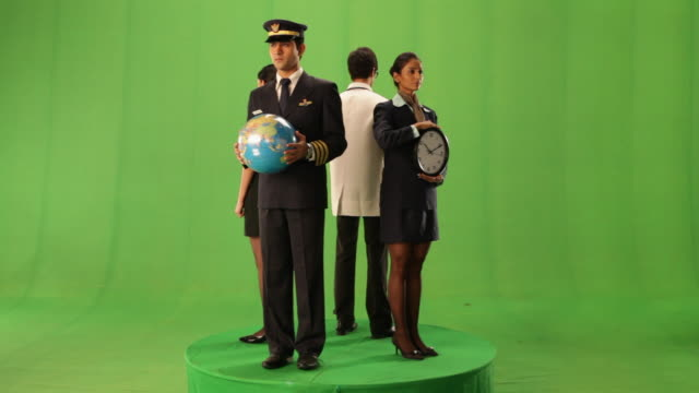 Four people holding different props