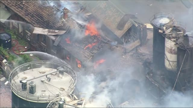 four people missing following explosion at cheshire mill air views / aerials destroyed and burning buildings at wood flour mills following explosion... - flour mill stock videos & royalty-free footage