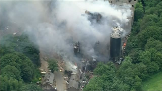 four people missing following explosion at cheshire mill air views / aerials destroyed and burning buildings at wood flour mills following explosion - flour mill stock videos & royalty-free footage