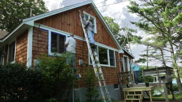 ws t/l zo four people re-painting the trim of lake woods cabin / bermen, maine, usa - diy stock videos & royalty-free footage