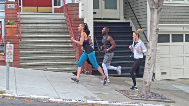 four people running in the streets of san francisco - jogging stock videos & royalty-free footage
