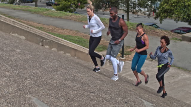 four people running steps on a park in san francisco - steps stock videos & royalty-free footage