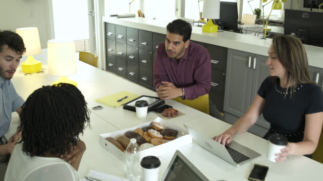 four people talking in an office - donut stock videos and b-roll footage