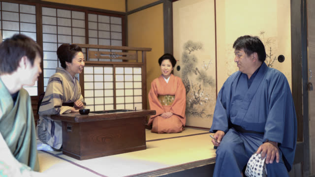 four people talking in japanese style clothing and room - tatami mat stock videos and b-roll footage
