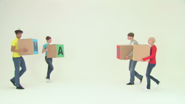 Four people walking then using blocks to spell team