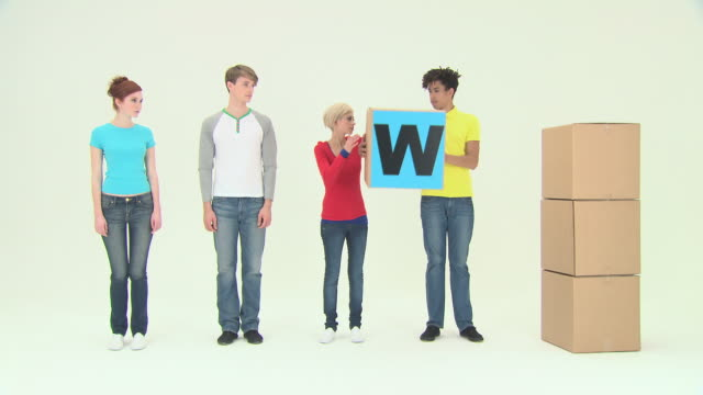 Four people walking then using blocks to spell work
