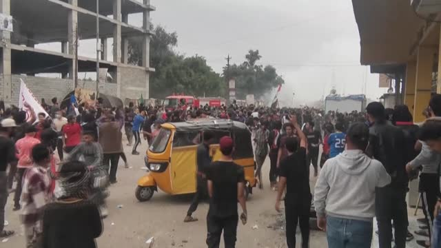 four people were shot dead and dozens wounded in iraq's south, medics said, in clashes between anti-government protesters and supporters of firebrand... - nasiriyah stock videos & royalty-free footage
