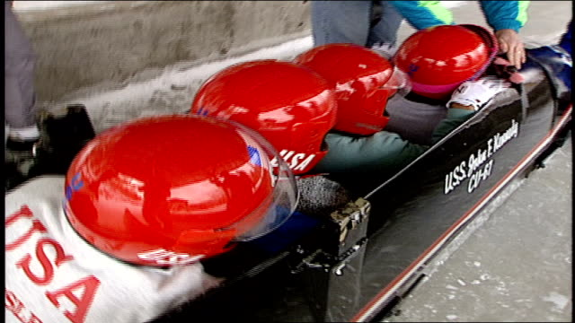 four people with red helmets in usa armed forces bobsled in lake placid, ny - red lake stock videos & royalty-free footage